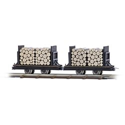 2 flat wagons with logs