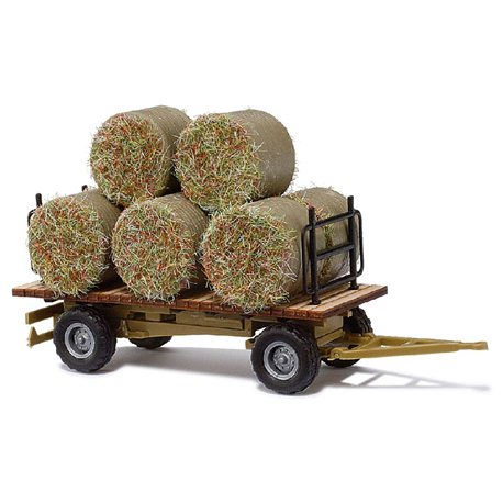 Hay bails on farm trailer